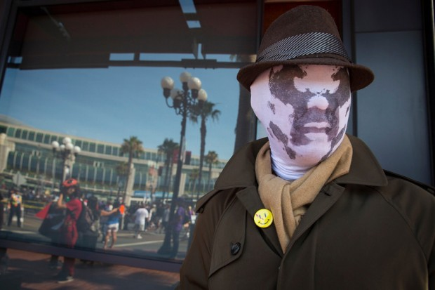 "Cosplayer Noel Victorio poses while dressed as Rorschach from the graphic novel ""Watchmen"" during the 2013 San Diego Comic-Con International"